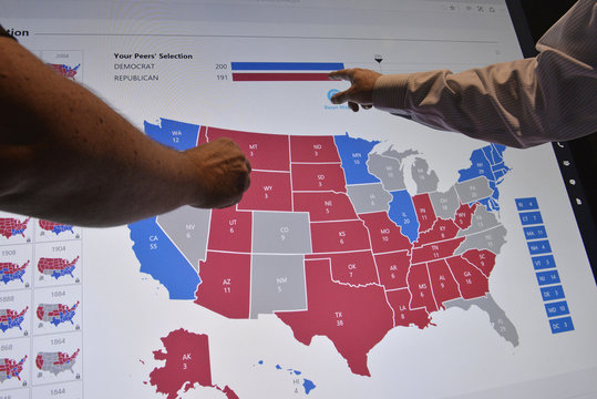 Delegates point to an electoral map at the Democratic National Convention in Philadelphia