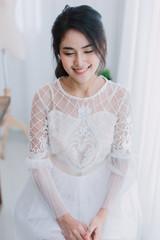 portrait of beautiful asian girl with beautiful bride dress.