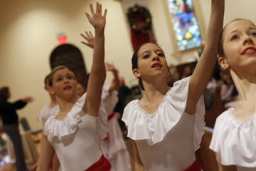 Members of the Tucson Dance Academy perform a routine at Saint Augustine Cathedral during the one year anniversary of the Tucson shooting in Tucson