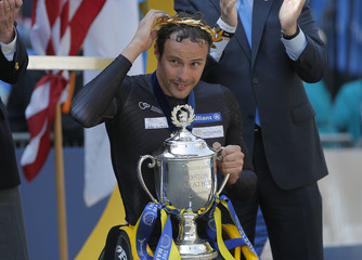 Marcel Hug of Switzerland accepts the first place trophy after winning men's wheelchair division of the 120th Boston Marathon in Boston, Massachusetts