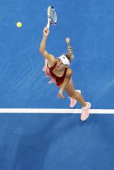 UAE Royals' Caroline Wozniacki of Denmark serves to Singapore Slammers' Daniela Hantuchova of Slovakia during their match at the International Premier Tennis League (IPTL) in Dubai