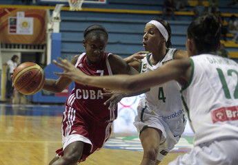 Cuba's Gelis dribbles the ball next to Brazil's Adriana Pinto and Damiris Dantas do Amaral during their semi-final basketball game at the FIBA Americas Championship for Women in Neiva