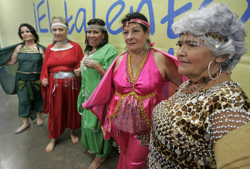 Women wait to perform during a fair for the elderly at the International Center for Fairs and Conventions (CIFCO) in San Salvador