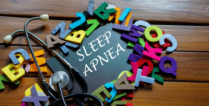 """Black board written with """" SLEEP APNEA """" and stethoscope on wooden back ground.Image with selective focus.Medical and health care concept."""