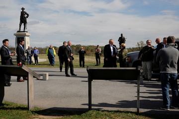 Trump listens to Park Ranger Kostic on a brief visit to Gettysburg National Military Park in Gettysburg, Pennsylvania