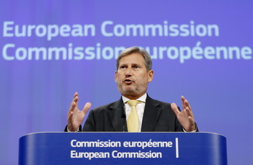 Hahn addresses a news conference in Brussels