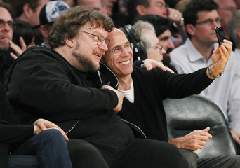 Director Guillermo del Toro and CEO of DreamWorks Animation and film producer Jeffrey Katzenberg pose for a photo at the NBA basketball game between the Los Angeles Lakers and the San Antonio Spurs in Los Angeles