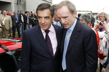 France's PM Francois Fillon and French former ski racer Jean-Claude Killy stand near a car before the start of Le Mans 24 Hours sportscar race