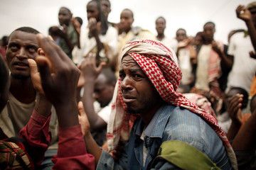 Ethiopian migrants, stranded on Yemen's border with Saudi Arabia, recite prayers appealing for evacuation to their home country from the western Yemeni town of Haradh