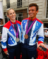 Equestrian rider Zara Phillips, daughter of Princess Anne, poses with diver Tom Daley during a parade of British Olympic and Paralympic athletes through London