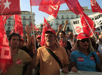 Subway workers shout slogans during a protest against wage cuts in central Madrid