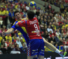Sweden's Andersson struggles with Serbia's Curkovic during their game at the Men's Handball World Championship in Malmo