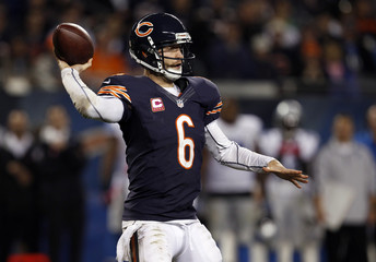 Bears quarterback Cutler throws a pass against the Detroit Lions during the second half of their NFL football game at Soldier Field in Chicago