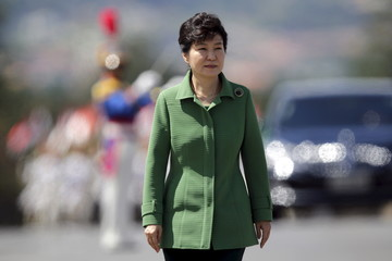South Korea's President Park Geun-hye walks past an honor guard before a meeting with Brazil's President Dilma Rousseff at the Planalto Palace in Brasilia