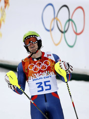 Britain' Ryding reacts in the finish area after competing in the first run of the men's alpine skiing slalom event during the 2014 Sochi Winter Olympics at the Rosa Khutor Alpine Center