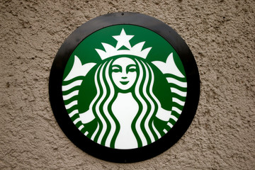 Company's logo is seen at a Starbucks coffee shop in Zurich