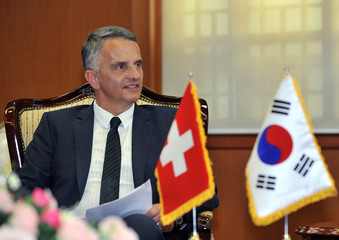 Switzerland's Foreign Minister Didier Burkhalter speaks to South Korea's Foreign Minister Kim Sung-Hwan during their meeting in Seoul