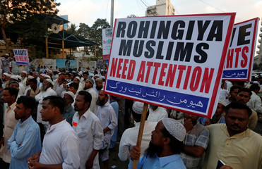 A Human Rights Network activist holds a sign during a demonstration against the persecution of Rohingiya Muslims in Myanmar, in Karachi