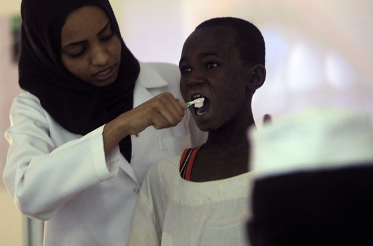 Children from Khalwas of the Jabel Awlia district attend oral hygiene lessons in Khartoum