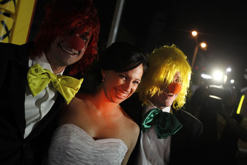 Fast-food fanatic Matienzo poses for a picture with friends dressed as clowns prior to her wedding at a McDonald's in San Pedro Garza
