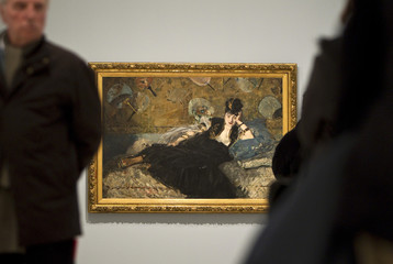 "A ""Woman With Fans"" painting by Manet hangs at an exhibition in Madrid"