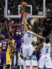 Los Angeles Lakers' Bryant shoots over New Orleans Hornets' Lopez during their NBA basketball game in New Orleans