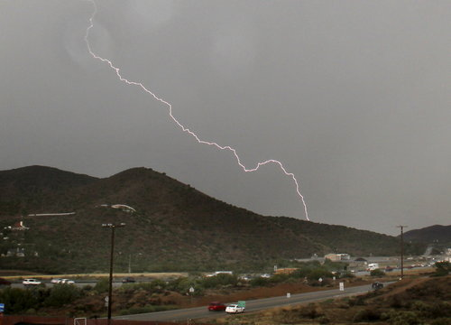 Lightning bolts come down during monsoon rains in the high desert area of Los Angeles County