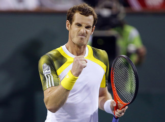 Andy Murray of Britain celebrates defeating Lu Yen-Hsun of Taiwan in Indian Wells, California
