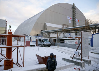 A general view shows the New Safe Confinement structure over the old sarcophagus covering the damaged fourth reactor at the Chernobyl nuclear power plant in Chernobyl