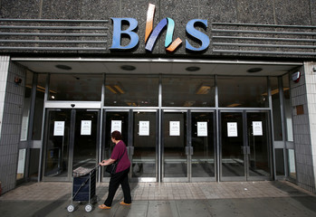 FILE PHOTO: A woman walks past the Wood Green branch of department store chain BHS after its final closure in London