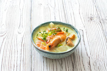 Soup with vegetables and seafood