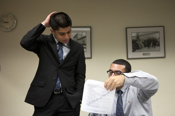 Guevara receives feedback on his math test from Noel Munoz during work readiness training at the Los Angeles Area Chamber of Commerce