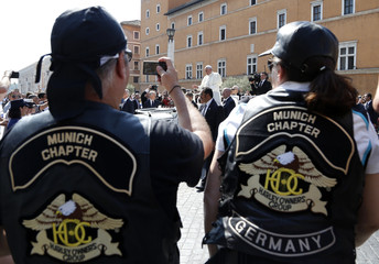 A Harley-Davidson biker takes a picture as Pope Francis blesses in Rome