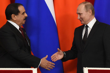 Russia's President Vladimir Putin shakes hands with Bahrain's King Hamad bin Isa al-Khalifa during a signing ceremony at the Kremlin in Moscow