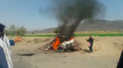 Still image video showing a car on fire in southwest Pakistan