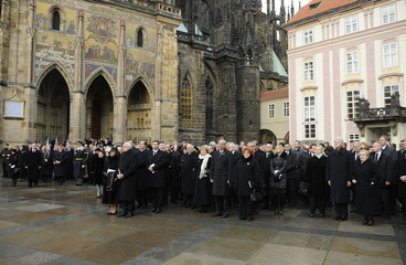 Czech's President Klaus and his wife stand with other Czech and foreign diplomats as they look at the coffin of late Czech President Havel in Prague