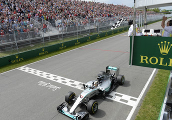 Mercedes driver Lewis Hamilton passes the checkered flag to win the Canadian F1 Grand Prix at the Circuit Gilles Villeneuve in Montreal
