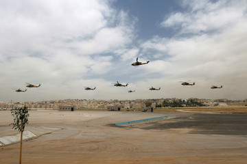 Jordanian special forces leave in helicopters while participating in an anti-terrorism drill during the opening of SOFEX at King Abdullah II Airbase in Amman