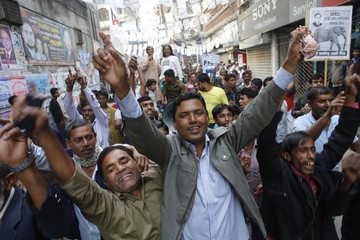 Supporters of Salim shout slogans as they take part in a campaign rally in Dhaka