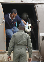 Glenn Costes of Philippines, a released aid worker from the Norweigan Refugee Council (NRC) prepares to disembark from a Kenya Air Force helicopter at the Wilson airport in Nairobi