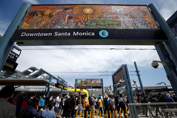 People alight at the Downtown Santa Monica station on L.A. Metro's new $1.5 billion Expo Line extension that connects downtown to the beach for the first time in 63 years, in Santa Monica