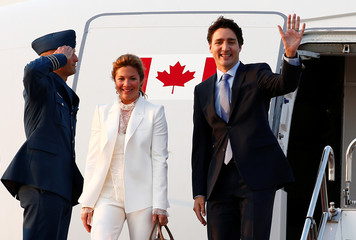 Canada's Prime Minister Justin Trudeau and his wife Sophie Gregoire-Trudeau arrive at Haneda Airport in Tokyo