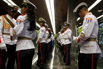 Military unit arrives to participate in a welcoming ceremony as Castro welcomes Obama at the Palacio de la Revolucion in Havana