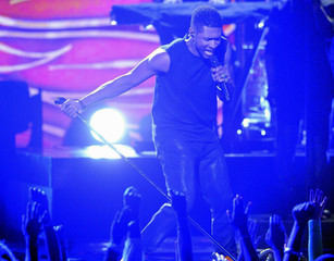 Usher performs at the 2012 BET Awards in Los Angeles