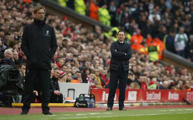 Plymouth Argyle manager Derek Adams and Liverpool manager Juergen Klopp