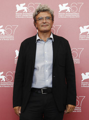 """Director Martone poses during a photocall for the movie """"Noi Credevamo"""" at the 67th Venice Film Festival"""