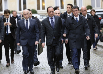 French President Francois Hollande leaves the Interior Ministry with Prime Minister Manuel Valls and Interior Minister Bernard Cazeneuve after a crisis meeting with French prefects in Paris