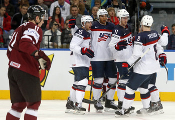 Nelson of the U.S. celebrates his goal against Latvia with team mates during the second period of their men's ice hockey World Championship Group B game at Minsk Arena in Minsk