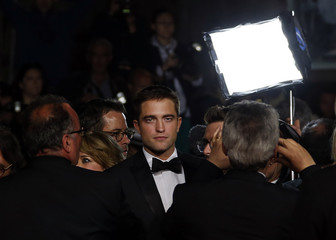 "Cast member Robert Pattinson poses on the red carpet as he arrives for the film ""The Rover"" out of competition at the 67th Cannes Film Festival in Cannes"