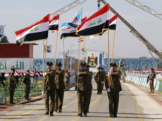 Soldiers march during a ceremony marking the anniversary of the founding of the Iraqi Air Defence in Baghdad